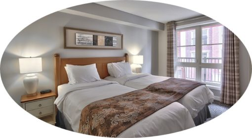 MLK Ski Weekend 2 Bedroom Village Suite Twin Bedroom cropped