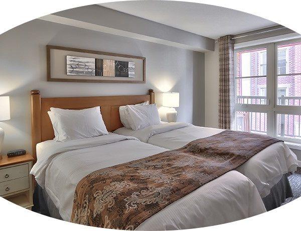 MLK Ski Weekend 2 Bedroom Village Suite Twin Bedroom cropped