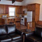 MLK Ski Weekend 5 Bedroom chalet living room upstairs view of kitchen