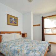 MLK Ski Weekend Black Ski Weekend 8 bedroom chalet bedroom with queen bed