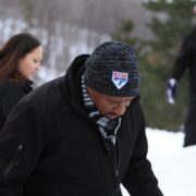 MLK Ski Weekend official 20th anniversary logo beanie worn in Canada tubing on slopes in snow