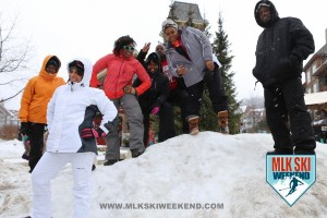 MLK Ski Weekend 2016 group action photo posing on mound of snow