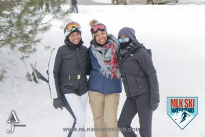 MLK Ski Weekend 2016 group photo of 3 ladies posing outside in winter gear doing ski activities
