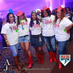 MLK Ski Weekend 2016 group photo of ladies in cowboy hats and cowboy boats at tshirt party