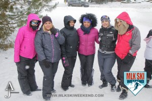 MLK Ski Weekend 2016 group photo of ladies posing outside in winter gear doing snow tubing
