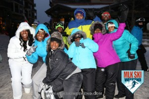 MLK Ski Weekend 2016 group photo of ladies posing outside in winter gear during night time in the village