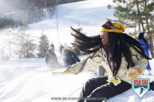 MLK Ski Weekend snow everywhere at ski resort girl with long hair throwing snow ball