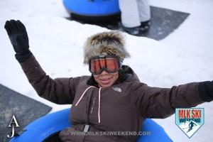 MLK Ski Weekend 2016 girl just finishing a run snow tubing