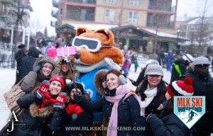 MLK Ski Weekend 2016 group of ladies psoing with mascot at outdoor village day party