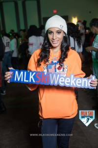 MLK Ski Weekend 2017 Black Ski Weekend brand ambassador holding sign