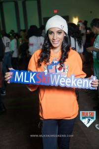 MLK Ski Weekend 2017 Black Ski Weekend brand ambassador holding sign