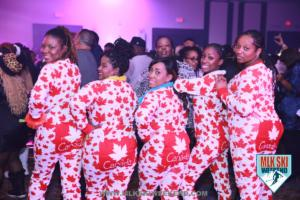 MLK Ski Weekend 2018 pajama party and girls wear Canada onsie at themed party