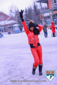 MLK Ski Weekend Black girl in red snow suit peace sign