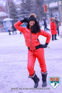 MLK Ski Weekend red snow suit in village